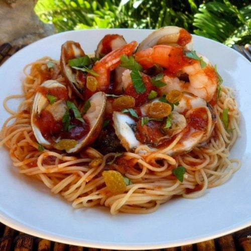 Angel Hair Pasta with Simple Red Sauce and Shellfish is made from quality organic tomatoes, various seafood such as clams, oysters, shrimp,  Italian herbs, and seasoning.