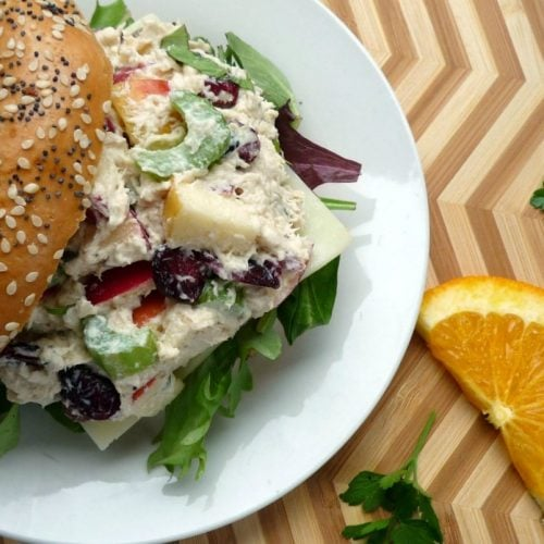 Deliciously made Chicken Salad with cranberries, apples, celery, pine nuts, and fresh basil, that's perfect on top of toasted bagels, crusty Italian bread, or even butter crackers.