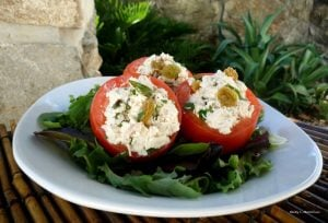 This Italian Chicken Salad in Tomato Cups on a Bed of Baby Greens is a super delightful and straightforward tasting.