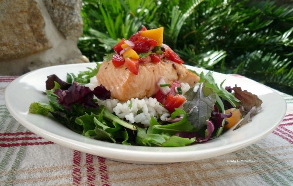 Sweet and savory are two terms that will come to mind when you taste this fantastic recipe of wild Salmon with fresh strawberry, pineapple, and mango salsa, over cilantro rice and a bed of greens.