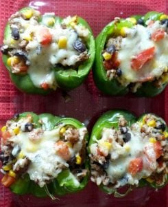 Healthy Southwestern Stuffed Green Peppers with Turkey are healthy and deliciously different. Made with ground turkey, rice, black beans, tomatoes, corn, cilantro and topped with fresh salsa and Monterey Jack cheese. I promise your family won't be bored at the dinner table tonight.