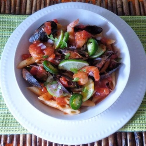 A flavor combination of Penne Pasta, fresh mussels, San Marzano Tomatoes, jalapeño peppers, limes, Spanish onion, Tequila, fresh spicy homemade tomato sauce seasoned with cilantro and other herbs.