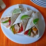 Chicken Fajitas made with tender Mojo Criollo marinated, boneless, skinless chicken breast seasoned with oregano, ground cumin, garlic, chili powder, crushed red pepper flakes, and fresh lime juice all wrapped snuggly in a warm, soft tortillaloaded with onions and peppers for the perfect Chicken Fajita.