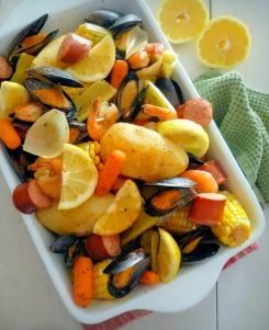"""Seafood Boil with Andouille Sausage is a wonderful combination of Mussels, Shrimp, Andouille Sausage, Potatoes, Carrots, and Spices is Guaranteed to make you smile. The recipe is simple and easy... It also comes with a Bonus """"It's made in one Pot"""", That means less of a mess for later."""