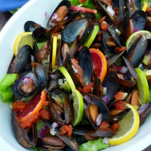 Mussels in Red Wine and Citruswill be the all-time inexpensive show stopper and jaw dropper starter to your meal combining delicious Mussels with Pinot Noir wine, fresh herb, with lemon, lime, and brilliant blood oranges that willnot only lend a wonderful flavor but make the recipe for Mussels in Red wine and Citrus stand out to your dinner crowd.