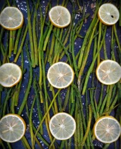 The perfect Roasted Asparagus with Lemon is a simple minimal ingredient delicious side dish to add to any meal all year round. Asparagus with the fresh, clean taste of sliced lemons, drizzled in coconut oil makes a perfect pairing with a hint of sea salt and freshly cracked peppercorns.