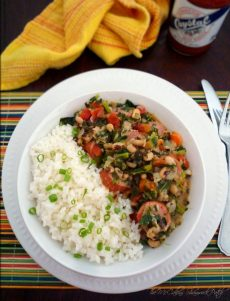 Cajun Black Eyed Peas are going to be a favorite on your dinner table combining black-eyed peas, collard greens, andouille or smoked sausage, onions, peppers, red bell peppers, celery, carrots, jalapeño peppers, tomatoes with chilies, hot sauce and Cajun seasoning for a Cajun-flavored tradition of the South.