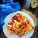 Cajun Style Andouille and Shrimp Pizzais one fantastic lunch or dinner menu item with spicyandouille sausage, delicious shrimp seasoned with Cajun Spices, then topped with spicy tomatoes, onions, red and yellow bell peppers, and warm gooey cheese.