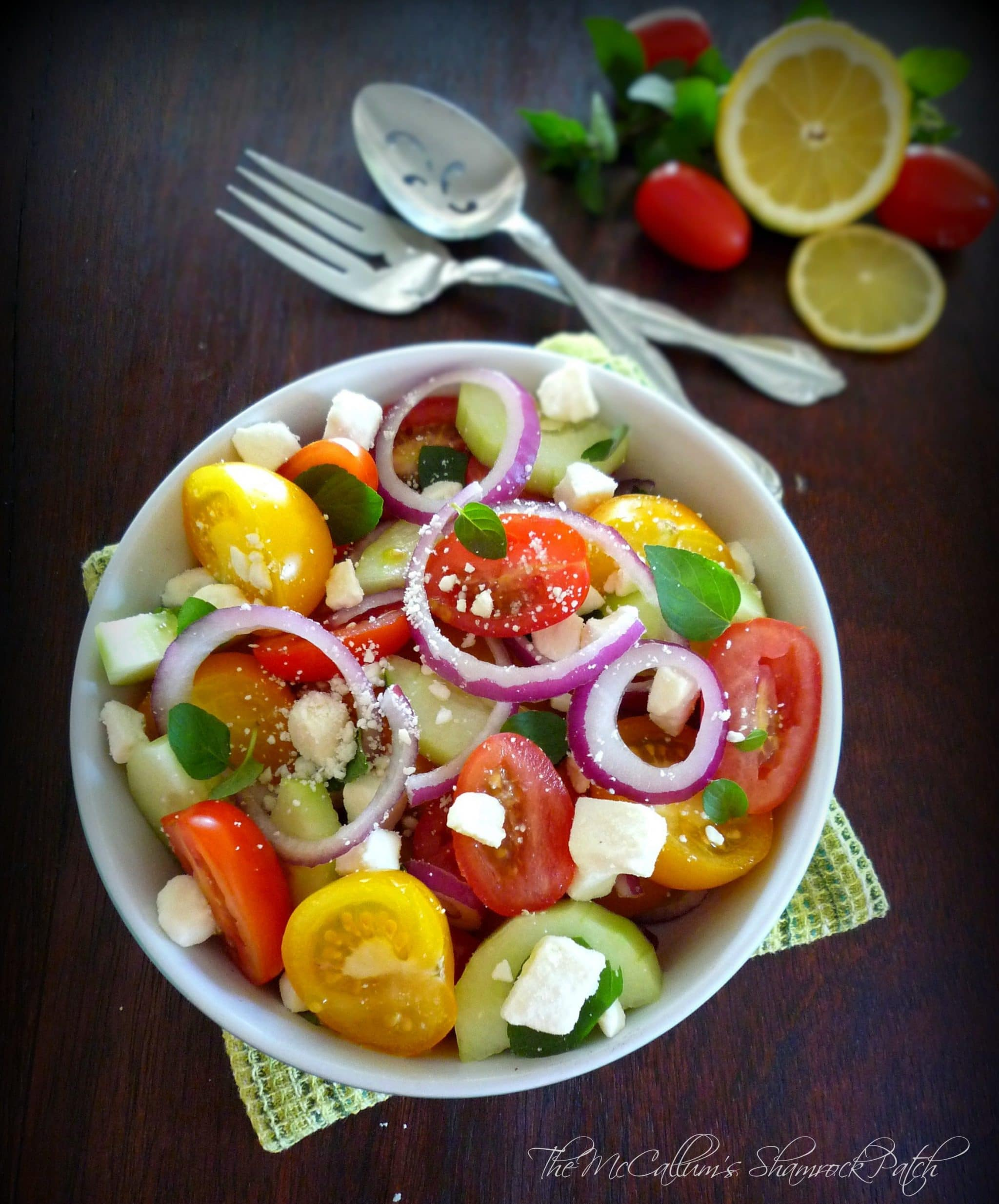 Tomato Feta & Mint Salad is a gorgeous yet simple salad to begin our lovely pre-spring here in sunny Florida combining juicy and delicious red grape tomatoes and lovely yellow cocktail tomatoes with crisp sliced cucumbers, red salad onions, Feta, and mint