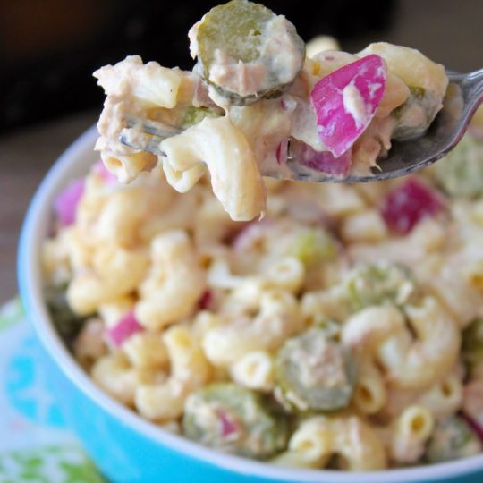 Tuna and Macaroni Salad is a simple, fresh tasting and a budget-friendly recipe we have made over the years in my household. Solid white albacore tuna, al dente macaroni, hard boiled egg whites, diced red onions, fresh parsley, sliced dill gherkins pickles, mayonnaise and a hint of freshly squeezed lemon juice make this Summer salad a winning combination for your next cookout