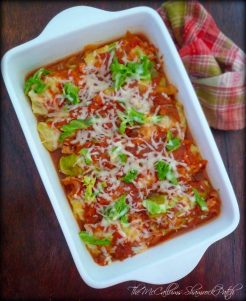 Basic Stuffed Cabbage Rolls are a delicious take on an Old Comfort Food that has well-seasoned ground beef, ground pork, rice, onions, and herbs all bundled in a perfectly cooked cabbage leaf and buried in a rich tomato-wine herb sauce with extra cabbage for additional texture.