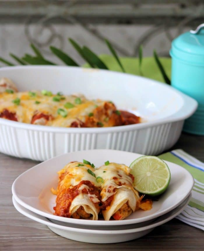 Chicken Enchiladas with Red Sauce are so darn good, you may want to make 2 batches of this Delicious Chicken Mexican goodness wrapped in fresh corn tortillas with fabulous homemade red sauce, a hint of lime and fresh Spanish herbs