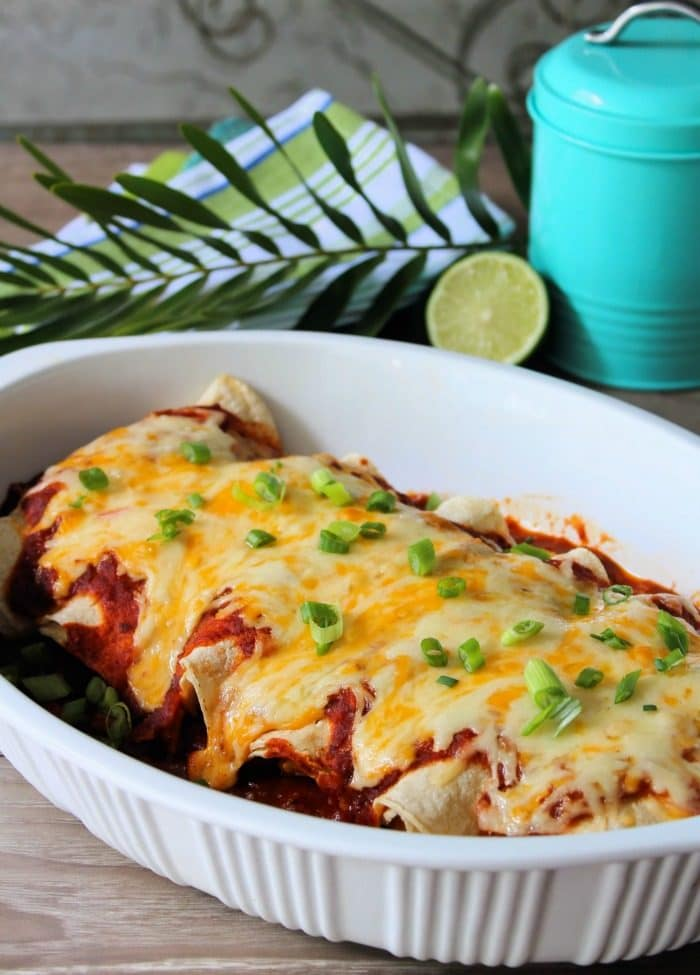 Chicken Enchiladas with Red Sauce are so darn good, you may want to make 2 batches of this Delicious Chicken Mexican goodness wrapped in fresh corn tortillas with fabulous homemade red sauce, a hint of lime and fresh Spanish herb.
