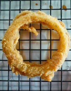 If you love good ole fashioned crispy fried onion rings and a Cajun Spices this is your Onion rings recipe you have been waiting all your life for; made with Yellow onions, self-rising flour, bread crumbs, Cajun seasoning, oregano, freshly ground black peppercorns, ground cayenne peppers, beer, Tabasco sauce, and fried to perfectly crispy in peanut oil