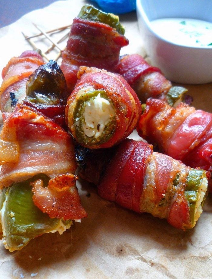 Southern-style Bacon wrapped Jalapeño Poppers aren't your ordinary oldJalapeño Poppers that you'll find at your local watering hole or Bar and Grill, these deliciously spicy, smoky Jalapeño peppers have been hollowed out, then filled to the brim with cream cheese that has been seasoned with Cajun seasoning then wrapped in thick slices bacon and grilled to perfection on the Bbq.