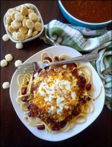 Cincinnati Chili is a delightful iconic concoction made famous by its ingredients and Mediterranean vibe of flavors which included lean ground beef, beef stock, tomato paste, and a variety of Mediterranean spices that were piled on top of a plate of spaghetti noodles and later topped with cheese, beans, and even onions in various spinoffs
