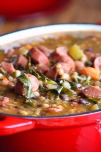 This hearty and delicious tasting Spicy Southern15 Bean Soup with Smoked Sausage is perfect for chasing away the wintertime blues. Made with some of the South's favoriteingredients such as; smoked sausage, 15 different beans, fresh collard greens, onions, celery, green bell peppers, carrots, garlic, diced tomatoes with chiles, Cajun seasoning, red pepper flakes, and Cayenne pepper served over white rice for the perfect balance of flavor.