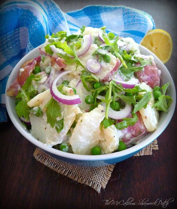 Potato Salad with Arugula, Peas, and Dill is a fantastic potato salad perfect for any season; made with sliced Red Potatoes, Peppery Arugula, Red Onions, Feta cheese, Sweet Peas, garden Fresh Dill weed, dressed in a creamy deliciously thick Greek Yogurt sauce.