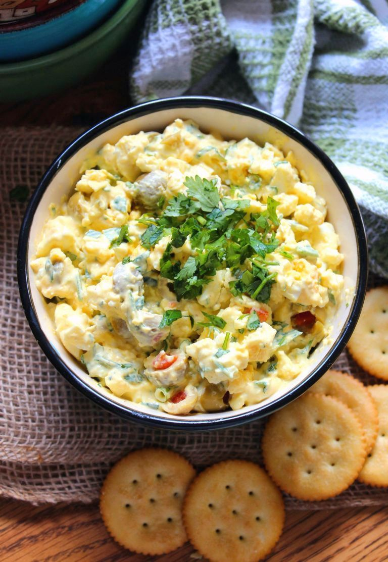 This delicious Southern-Style Egg Salad is the perfect lunch idea that will have you wondering why you didn't make more of it for the family to enjoy.  Southern-Style Egg Salad is super easy to make combining hardboiled eggs, Duke's mayonnaise, thinly sliced celery, sweet Vidalia onions, green olives, scallions, pimento, and yellow mustard served on rich buttery crackers.