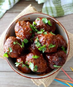 These delicious boozy Southern-style Bourbon Meatballs are going to be the hit of your next gathering; be ready for people to immediately run over to the meatballs on the buffet table and beg for this retro Southern recipe.