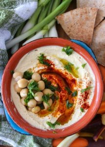 This delicious handed down Lebanese Hummus Recipe comes off without a hitch when made. It has a super creamy texture and fabulous flavor. It is made from dried chickpeas, quality tahini, garlic, fresh lemon juice, paprika, extra- virgin olive oil, and fresh parsley for the best tasting Lebanese Hummus to date.
