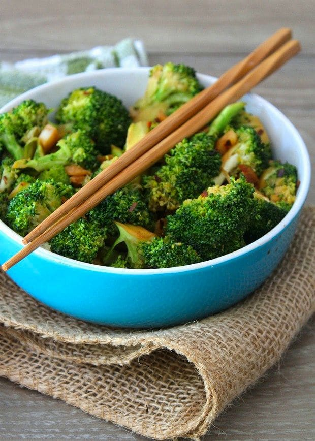 Spicy Asian-Style Broccoli is a deliciously simple dish made from broccoli spears tossed with soy sauce thinly sliced fresh garlic, soy sauce, chili pepper flakes, sweet rice vinegar, sesame oil, and a hint of brown sugar. Hands downthis Spicy Asian-Style Broccoli will beat every takeout container of Chinese you can get without exception.