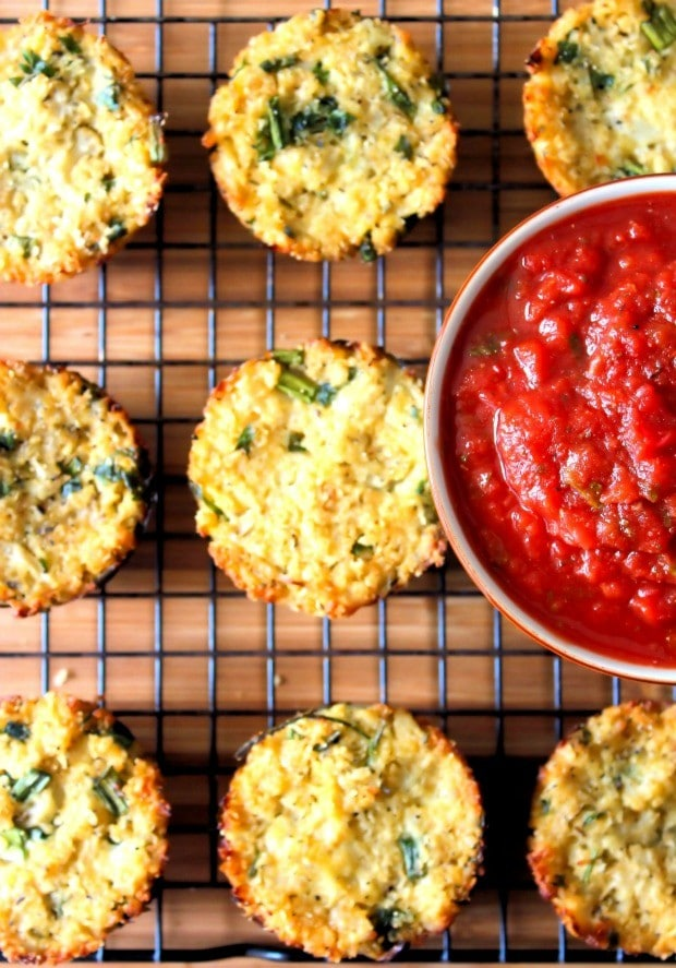 What's not to love about these Crispy Cauliflower Cakes with Marinara Sauce? These easy to make, husband approved Cauliflower Cakes are delicious!