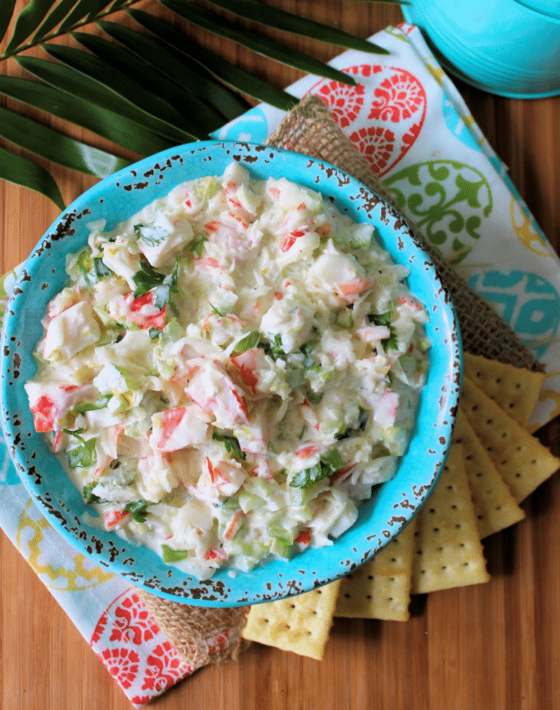 Creamy Crab Salad is one of the mostdeliciousyet easiestsemi-homemade salads you'll ever have the pleasure of making. For years this creamy crab salad has been my secret go-to recipe for impromptugatherings with friendsand family members at reunions, work potlucks, and even church gatherings.
