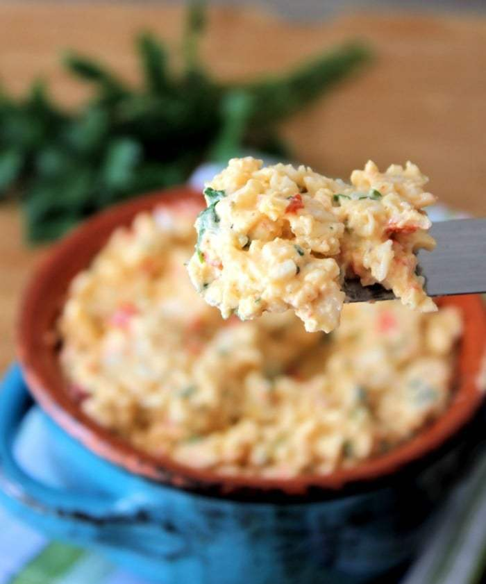 This super simple to make Cajun Crab Spreadis packed with amazing bold Cajun and Crab flavors. Serve it over butter crackers, Triscuits, Wheat Thins, or toast points at your next pool party, family reunion, or church potluck and watch the crab lovers faces light up with delight over the Cajun treat.