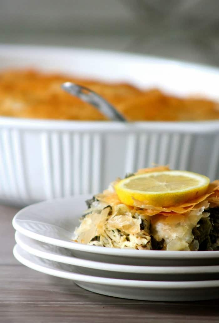 Spanakopita - Greek Spinach Pie is a flavorful savory pie filled with spinach, eggs, and feta. This delicious spinach and feta pie is an iconic Greek dish that can be enjoyed as a starter for the main course, an accompaniment to the main course, or a main course if served with a light salad, cheese, and other various complementary items.