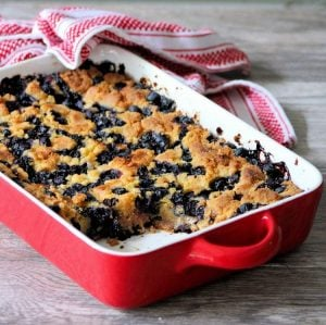 This easy to follow 4 Ingredient Blueberry Dump Cakerecipe combines fresh organic Blueberries, yellow cake mix, plus rich and creamy unsalted real butter and vanilla come together to make the best easiestBlueberry Dump Cake you'll ever taste.