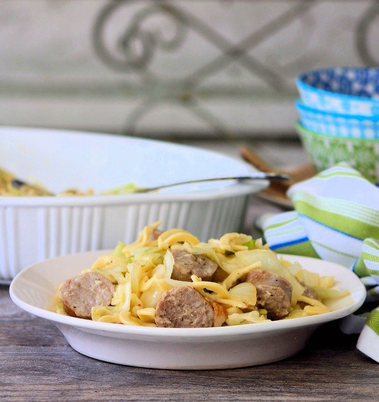 Cabbage Sausage and Kluski is a simple to make, yet, deliciously flavorful Pennsylvania Dutch Recipe made from fried green cabbage, lightly browned bratwurst sausages, garlic, onions, butter, and Polish Kluski Noodles that your entire family is sure to love.