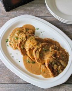 My mom has made these for years, and let me tell you, There is nothing more delicious than herLightly breaded pork chops that have been smothered in a rich flavorful savory and well seasoned homemade gravy. Did I mention they almost melt in your mouth? Oh, yes they are just that darn tender.