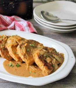 Southern Smothered Pork Chops are a classic comfort food at it's best in the South. Tender, Juicy, flavorful, melt in your mouth Pork Chops smothered in a wonderful gravy that takes ordinary Pork Chops to an entirelynew levelof a perfectly deliciously mouthwatering meat and gravy meal.