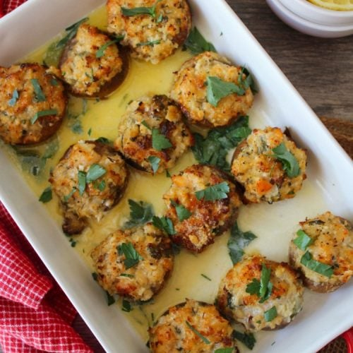 Crab Stuffed Mushrooms are the ultimate flavorful seafood appetizer. Deliciously juicy white mushrooms Stuffed to the hilt with seasoned tender lump crab meat, cheese, breadcrumbs, and herbs, all baked in the oven to glorious perfection.