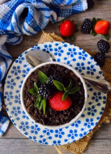 This adorable Dirt Pudding Recipe is a favorite among both kids and adults alike. Layered with chocolate pudding, Oreos, strawberries, blackberries, and gummy worms to make a delicious treat everyone will love at family gatherings, potlucks, or even picnics.