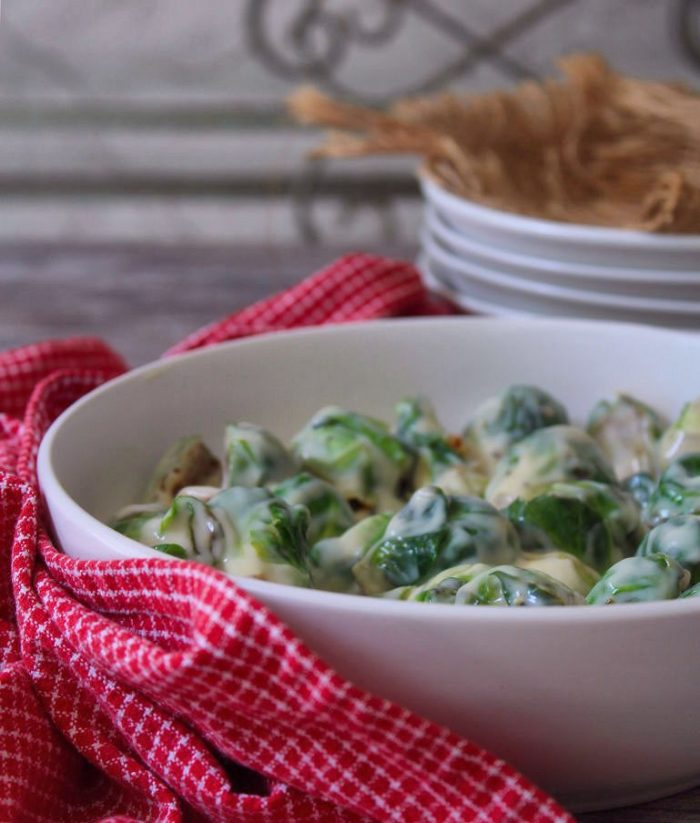 Roasted Brussels Sprouts with Parmesan Cheese Sauce is a wonderfully cheesy and savory makeover for ordinary Brussells Sprouts; made with a deliciously flavorful and creamy parmesan sauce that totally makes them completely irresistible side dish to serve all year long