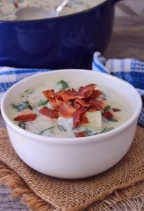Potato Spinach Bacon Soup is a classic, flavorful belly-warming comfort food recipe at it's finest. Combining red potatoes, leftover mashed potatoes, fresh spinach, and other veggies with hickory-smoked bacon in a cloud of delicious creaminess.