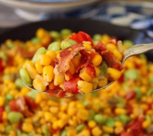 Southern-style Succotash is chock full of delicious healthy organic veggies like sweet yellow corn, lima beans, onions, tomatoes, and crisp smoked hickory bacon this Classic Southern side makes the perfect potluck dish.