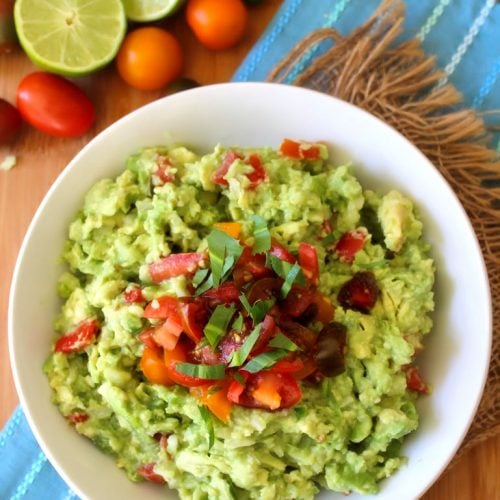 This easy to make Authentic Guacamole recipe is made with simple to find fresh organic ingredients that will scream fresh and flavorful to all your family and friends. Plus an easy to follow guide to keeping your fresh Guacamole from browning.