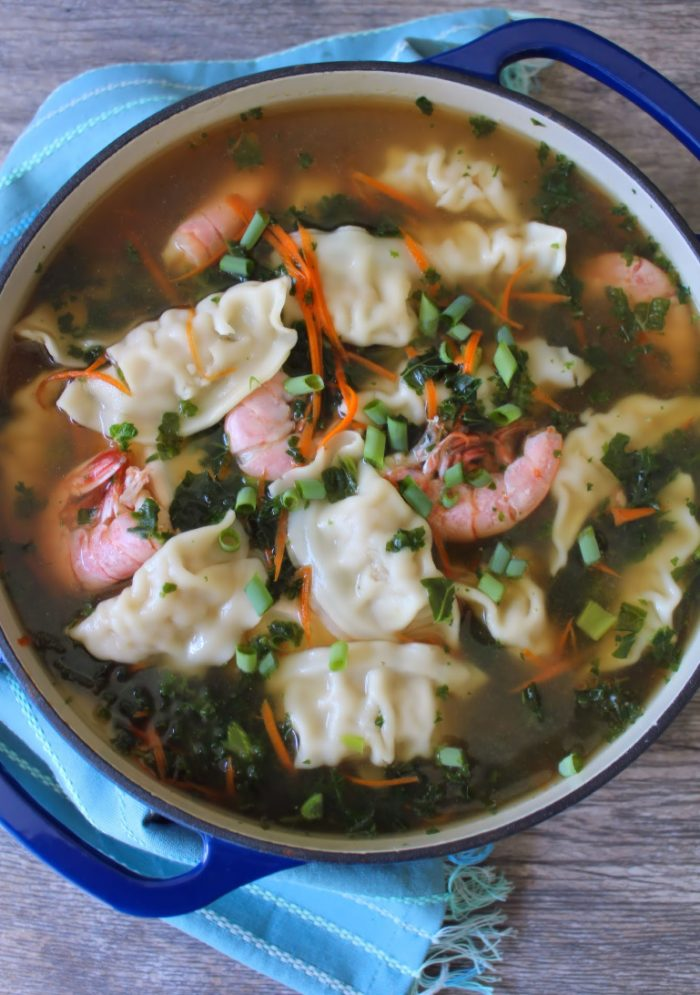 This deliciously flavorful Potsticker Soup is an amazing and hearty soup full of rich ingredients such as Shrimp Potstickers, decadent jumbo pink shrimp, kale, carrots, scallions, and Chinese spices cooked in a delicious shrimp stock.