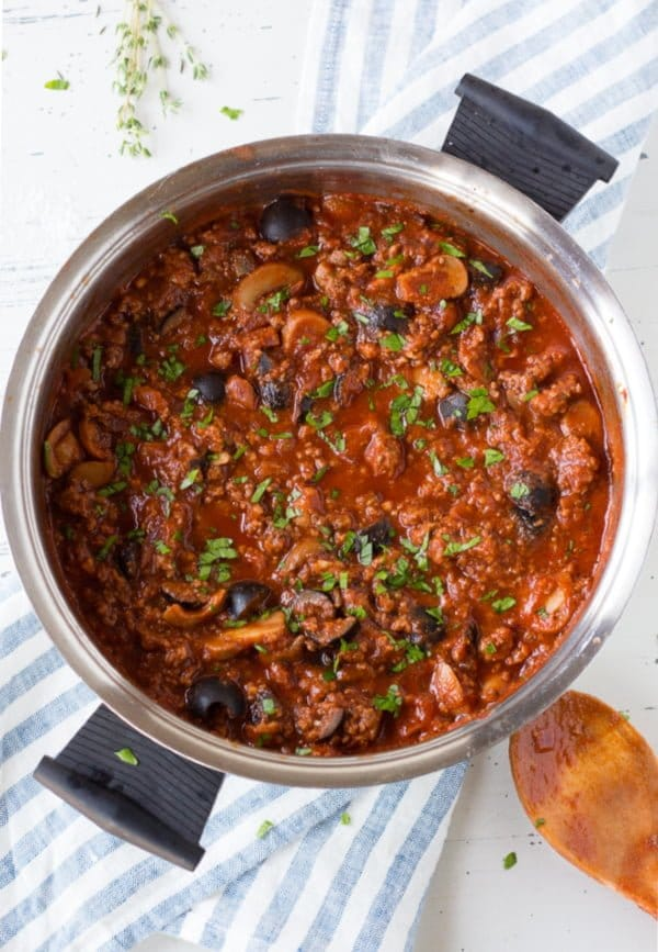 [GF-Paleo-W-30] This Easy Meat Sauce recipe is a healthy homemade sauce to go over your spaghetti or zucchini noodles. Made with ground beef, olives, and mushrooms in a tomato sauce that simmers to perfection, it's great for a simple weeknight dinner.- Hot Pan Kitchen