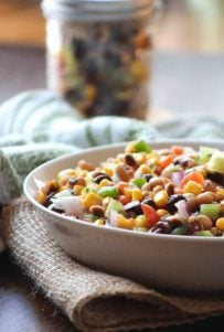 Cowboy Caviar {black-eyed Pea Salsa} aka Texas Caviar is the delicious Southern cousin of Mexican Black Bean Salsa made with black-eyed peas, sweet corn, diced red plum tomatoes, chopped spicy jalapeño peppers, crisp celery, diced cucumber, red onions, finely sliced green onion, chopped fresh cilantro, and served with crunchy tortilla chips