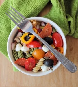 Classic Italian Pasta Salad is made with organic tri-color rotini, packed with tons of vegetables, cheeses, meats, and coated in a homemade vinaigrette. It's The perfect recipe to feed a crowd for picnics, potlucks, office parties, and family gatherings.