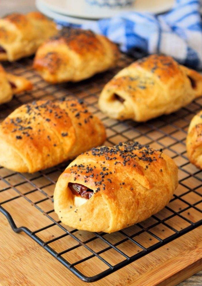 Easy Guava and Cheese Pastries are the cheater version of Cuban Pastelitos. Made with a delicious flakey crescent roll pastry then filled with sweet guava and cream cheese, lightly brushed with an egg wash, and then topped with poppy seeds.