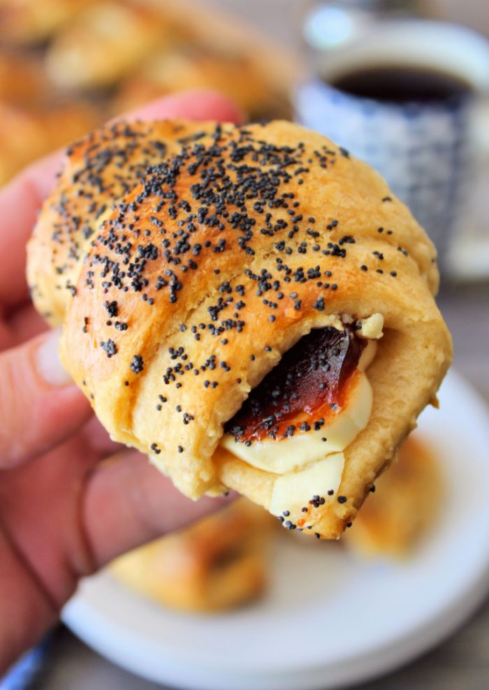 This recipe for Easy Guava and Cheese Pastries is an easy variation of pastelitos de guayaba. Made with a delicious flakey crescent roll pastry, then filled with sweet guava and cream cheese, lightly brushed with an egg wash, and then topped with poppy seeds for extra pizzaz.