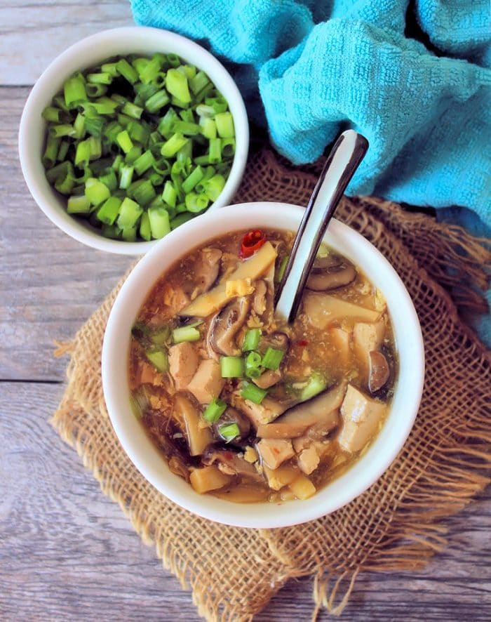 Easy Hot and Sour Soup is the winning combo of savory yet spicy, made with Shiitake mushrooms, bamboo shoots, tofu, and eggs in a flavorful seasoned broth. Deliciously flavored Hot and sour soup can be found on most takeout menus or even Chinese buffet line in the US. However, nothing beats a homemade version of Hot and Sour soup made with love in your kitchen.