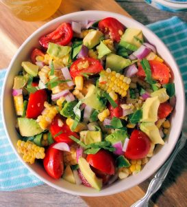 Southern Corn Salad is hands down one of the best Iconic salads for summer. This summer-friendly salad is made with grilled corn on the cob, avocados, fresh organic tomatoes, red onions, jalapeno peppers, fresh herbs, and a homemade dressing.