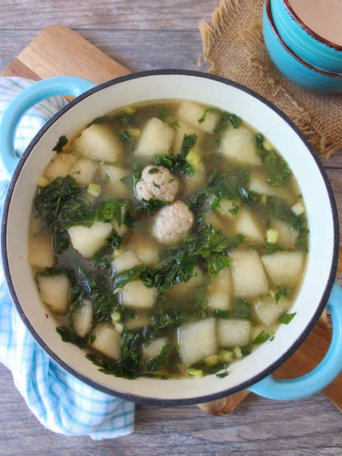 Winter melon soup is a delicately flavored and comforting dish that is usually served on cooler days. The winter melon is cooked in a rich-tasting chicken broth until soft. The addition of tiny tender homemade pork meatballs and fresh organic kale makes this simple soup taste delicious and hearty. Winter Melon Soup is very simple to prepare and is perfect to accompany a weekday dinner.
