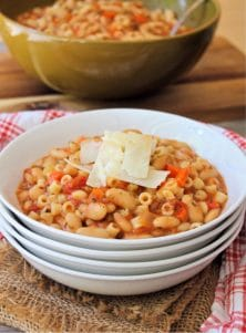 Italian Pasta and Bean soup is a comforting super thick and hearty soup made from organic cannellini beans, crushed organic tomatoes, celery, onion, garlic, small pasta, herbs, and spices. Pasta and bean soup is perfect for fall and winter meals and pairs well with crusty Italian bread and a simple salad.
